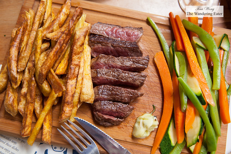 Seared Wagyu steak with sauteed vegetables and sweet potato fries