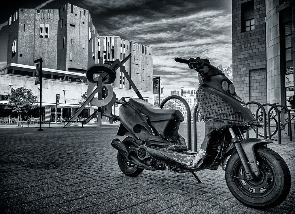 Scooter on the Denver Arts Museum Plaza - black & white