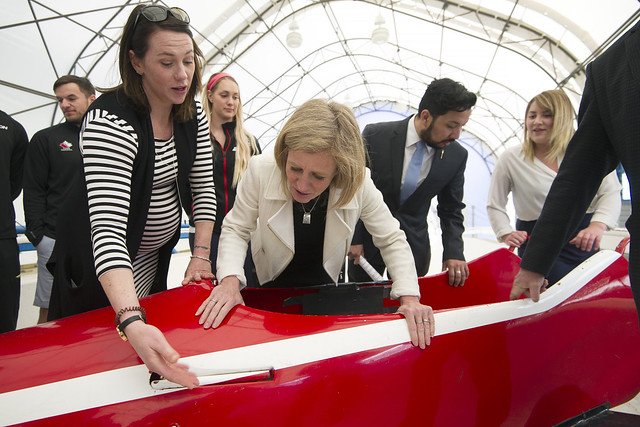 Premier Notley examines a bobsleigh at WinSport in Calgary