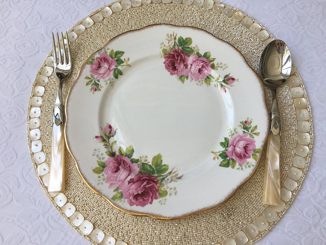 OMB dinner table setting, pink plate