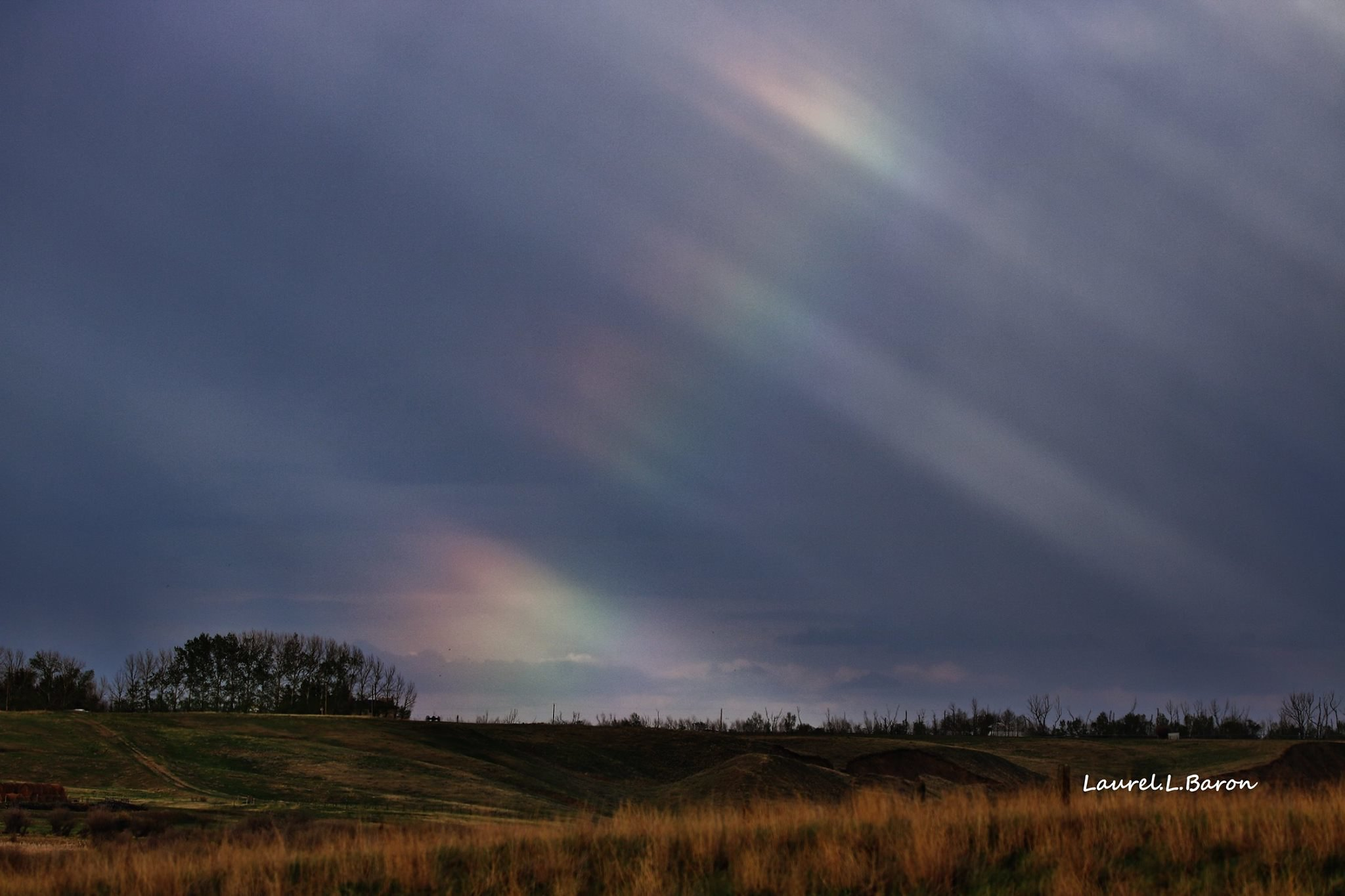 news storm chaser spots beautiful shimmering prairie rainbow