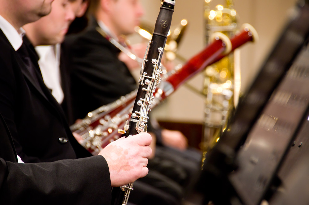 photo of wind instrument players in an orchestra