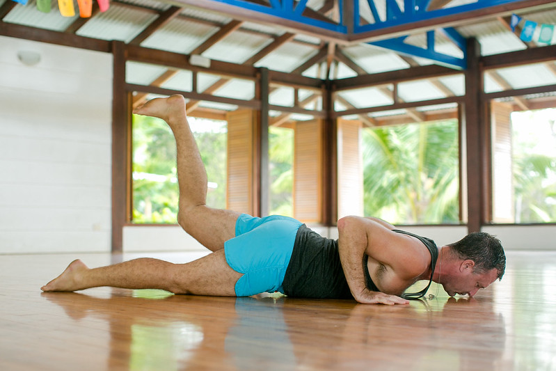 "How to practice yoga - http://YogiAaron.com""></center></p><p>&nbsp;</p><h3><strong>Step 5 &#8211; Dynamic Ardha Salabasana /  Dynamic Half Locust Pose &#8211; 5 times each side</strong></h3><p>Lie face down on the floor. Lift one arm, your head, chest/upper torso and the opposite leg up as high as you can while squeezing the glute of your lifted leg, and then slowly lower down. Repeat on the other side.</p><p>Do both sides five times. Take your time as you do this. Go slowly and see how much height you can get in your torso as you lift up.</p><p>You will notice and feel all of your lower back muscles contracting.</p><p>If you are new to this exercise, it will take you some time to strengthen your muscles. But over time, you will notice that you will not have any more lower back pain.</p><p><center><img src="