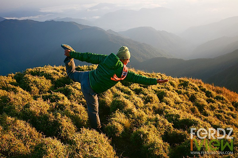 Doing a yoga Dancer's pose at the summit of Mt Pulag