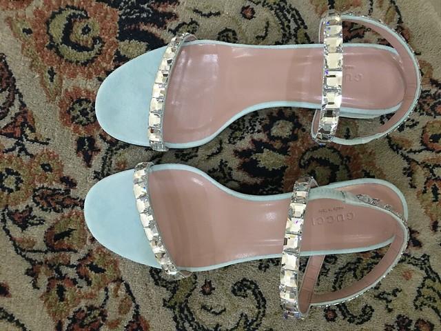 Blue Gucci sandals from Oyen