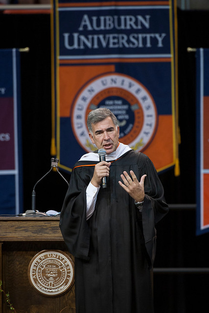 Mark Winne speaks at an Auburn University commencement ceremony.