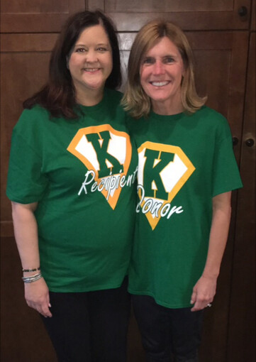 Susannah Cleveland and Martha Dazzio pose for a picture while wearing their kidney recipient and kidney donor shirts.
