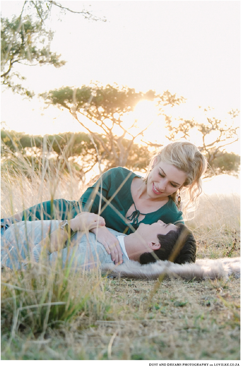 Serene winter engagement shoot with pops of green
