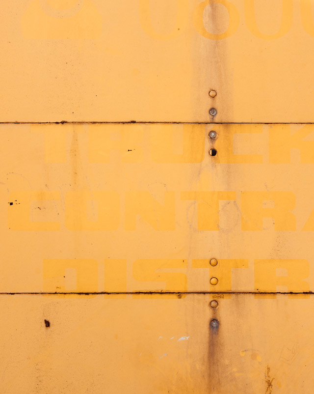 yellow surface with faded type