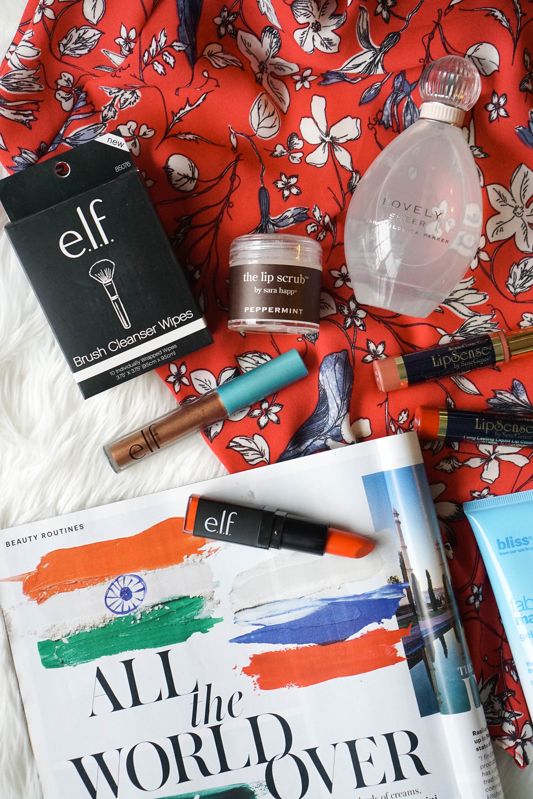 My May Beauty Essentials elf cosmetics Moisturizing Lipstick Orange Dream Review Brush Cleanser Wipes Living After Midnite Jackie Giardina
