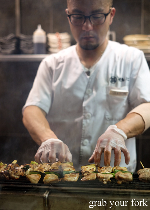 Head chef Akihito Marui on the yakitori grill at Yakitori Jin in Haberfield Sydney