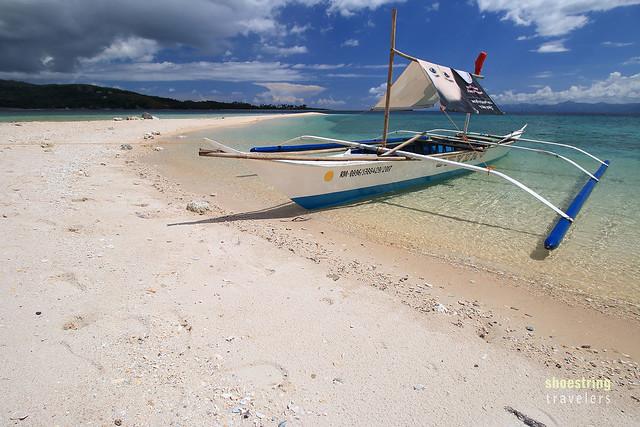 boat at Logbon Island's sandbar