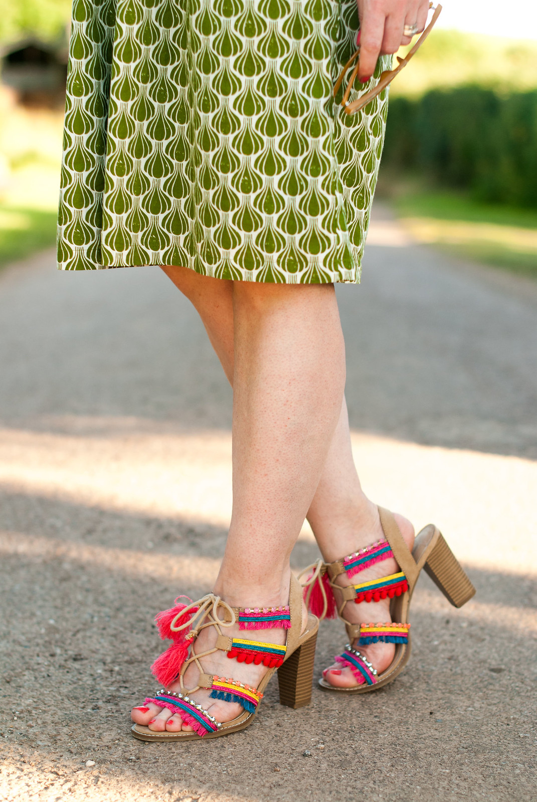 Hot weather style: Printed green summer dress pompom and tassel embellished sandals | Not Dressed As Lamb, over 40 style