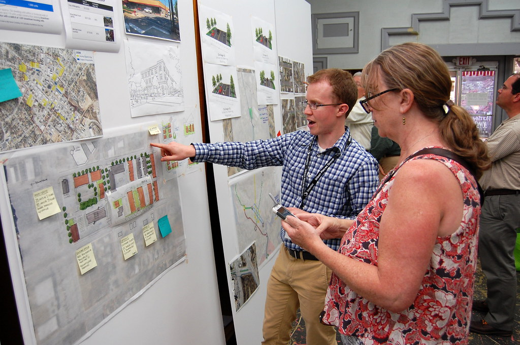A Stantec staffer discusses ideas with a visitor