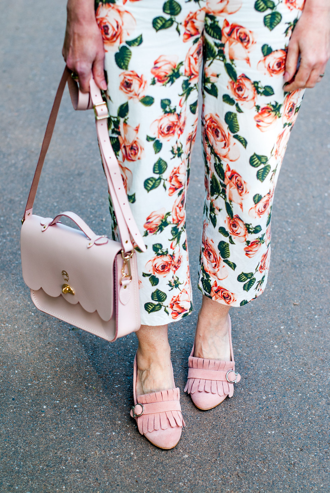 Blush pink summer outfit: Pink sweater with heart motif cropped floral trousers pants blush pink suede Gucci-style heeled loafers pink satchel | Not Dressed As Lamb, over 40 style