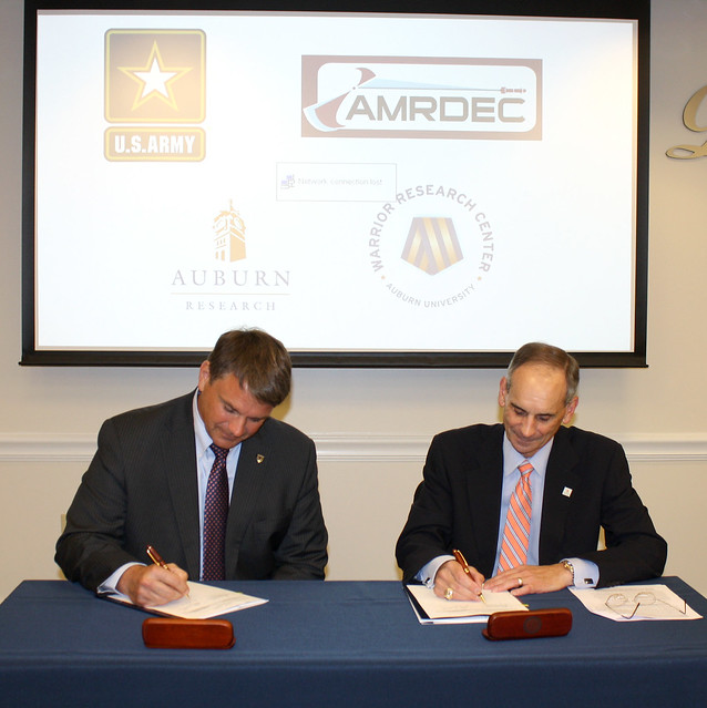 Jeff Langhout and John Mason sign a research agreement.