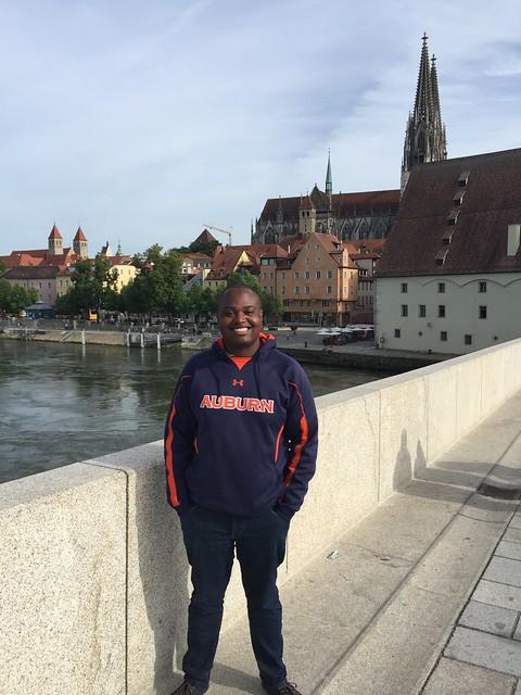 Photo of graduate Benjamin (Ben) Cole on a bridge in Regensburg, Germany