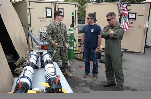 TODENDORF, Germany - Capt. David Burke, middle, and Cmdr. Don McNeil, left, receive a familiarization brief from Lt. Ben Fernandez during exercise BALTOPS 2017, June 5.