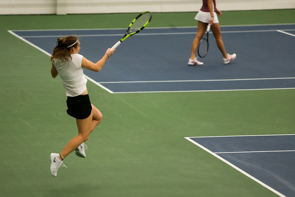 Zoey Douglas returns a shot during the doubles tennis match against Indiana's Madison Appel and Kim Schneider.