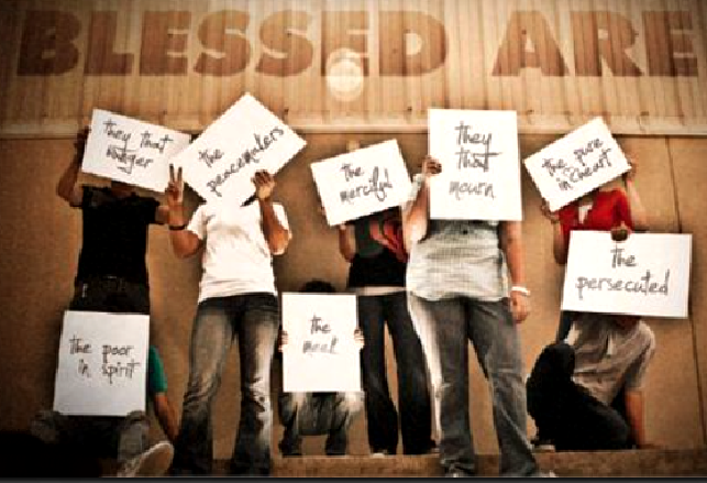 Students hold signs with the Beatitudes written on them