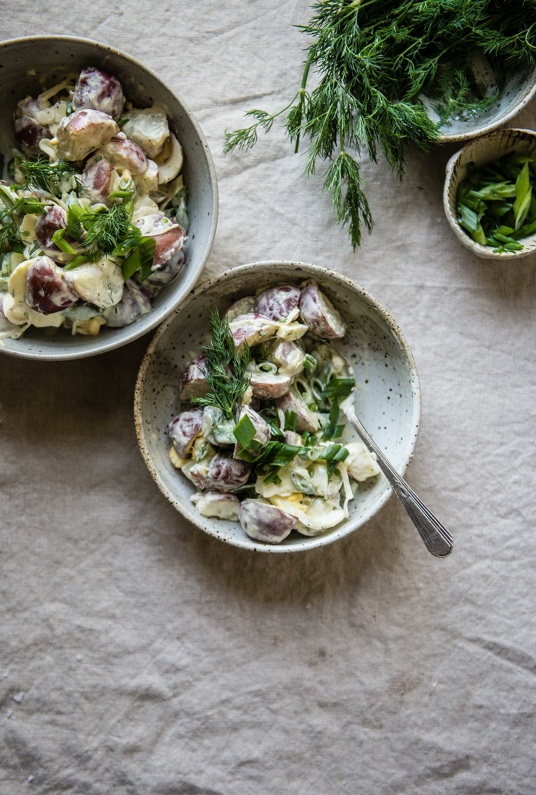 potatoes with sugar snaps, pickled shallots, & dill | two red bowls