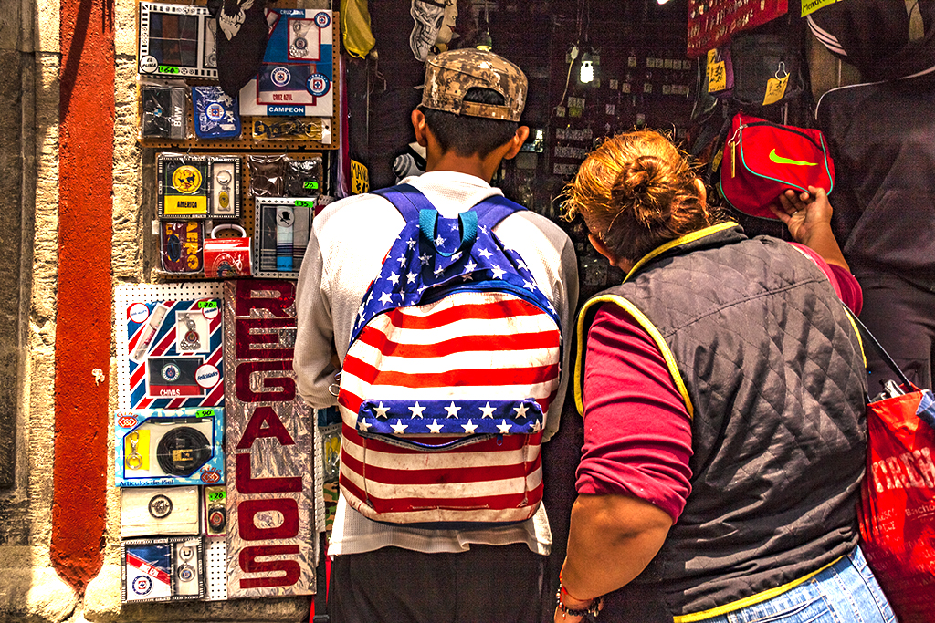 Man with American flag backpack--Mexico City