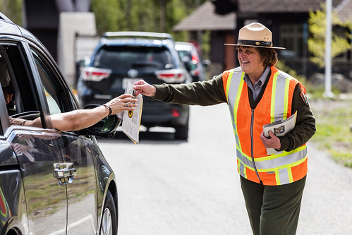 Ranger welcomes people at West Entrance | by YellowstoneNPS