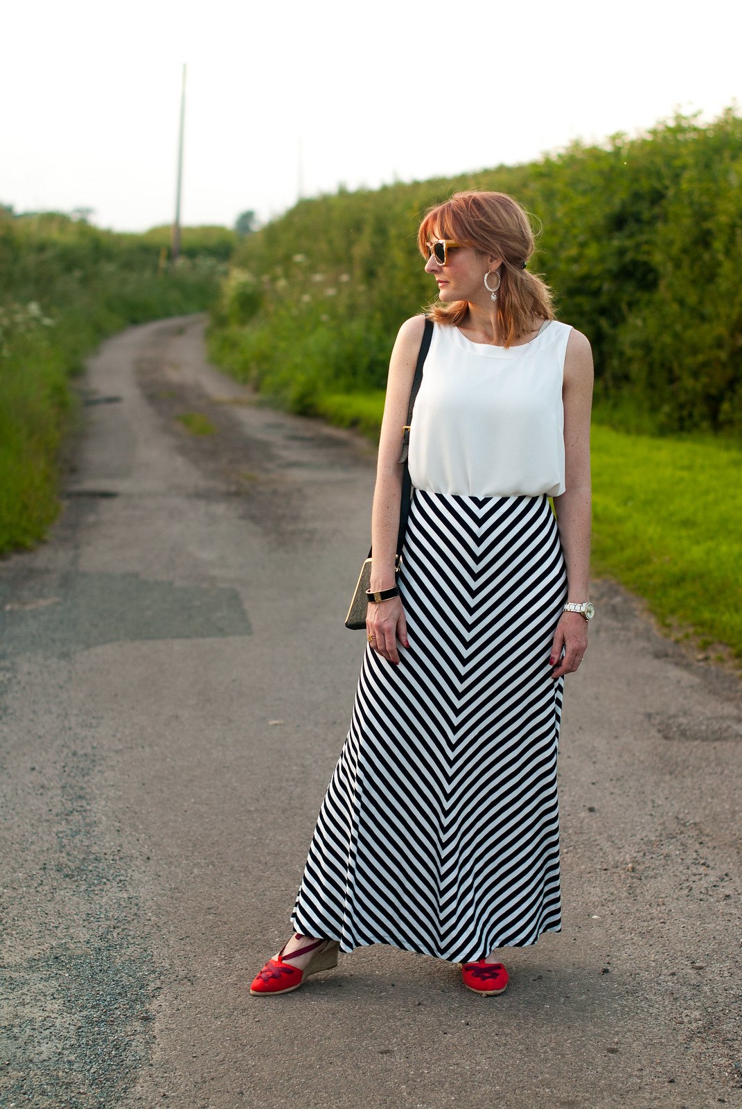 Black and white monochrome, summer style: Striped maxi skirt  loose white sleeveless blouse, red lace-up espadrilles  statement sunglasses and earrings | Not Dressed As Lamb, over 40 style