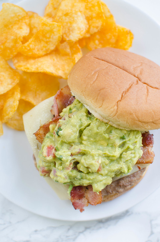 Guacamole Bacon Burger - delicious turkey burgers topped with pepper jack cheese, crispy bacon, and creamy guacamole. So spicy and delicious!