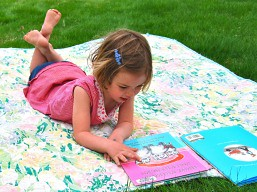 girl_reading_on_lawn