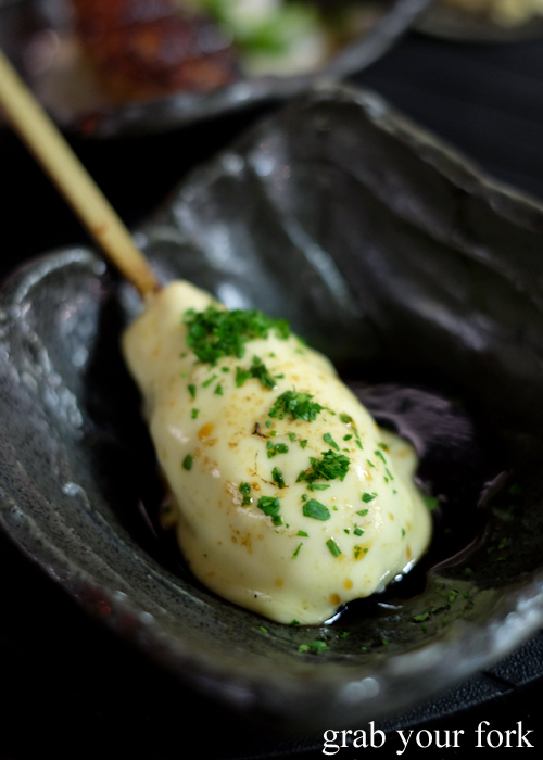 Tsukune meat ball with melted cheese at Yakitori Jin Japanese restaurant in Haberfield Sydney