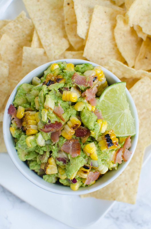 Charred Corn and Bacon Guacamole - a delicious and easy twist on the classic! A super simple guacamole recipe with grilled corn and bacon!