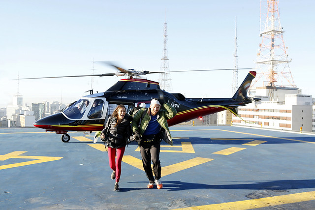 Brooke Camhi and Scott Flanary depart from a helicopter on top of a building.