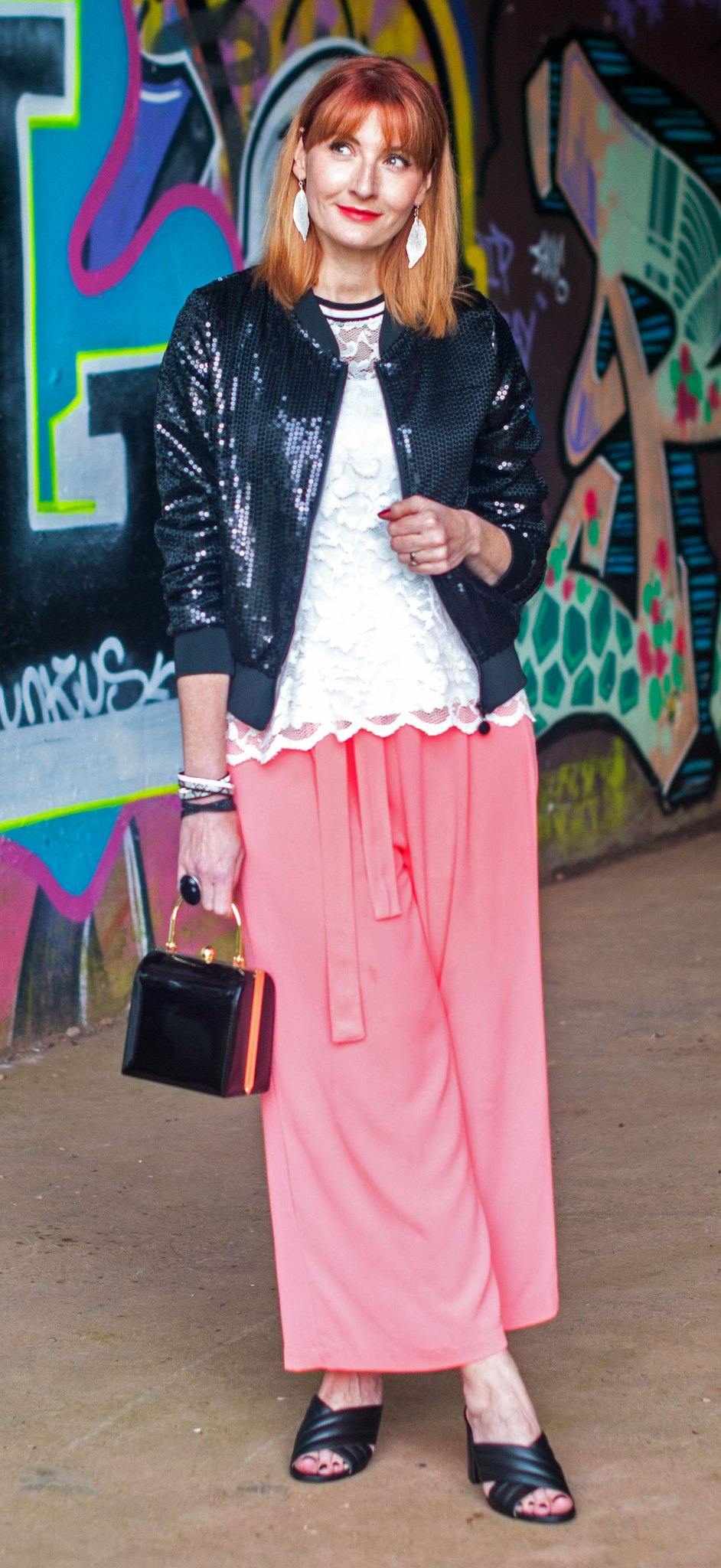 A day-to-night summer outfit: Sequin bomber jacket \ sporty lace top \ coral cropped trousers wide leg pants culottes \ rose gold espadrilles \ black crossover mules | Not Dressed As Lamb, over 40 style
