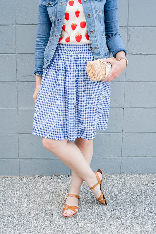 strawberry graphic tee + J.Crew gingham skirt + denim jacket +straw clutch + summer casual outfit | Style On Target blog