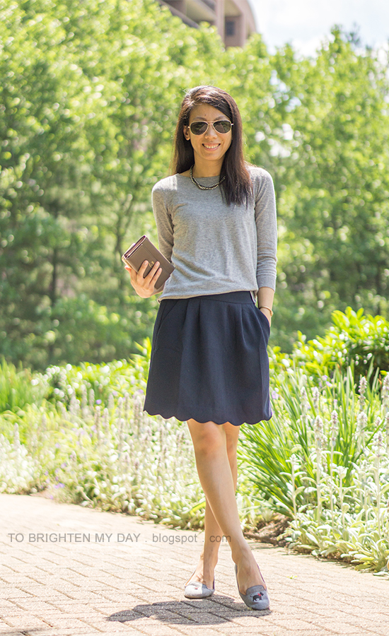 gray button back sweater, taupe clutch, navy skirt with scallop hem, embroidered flats with scotty dog