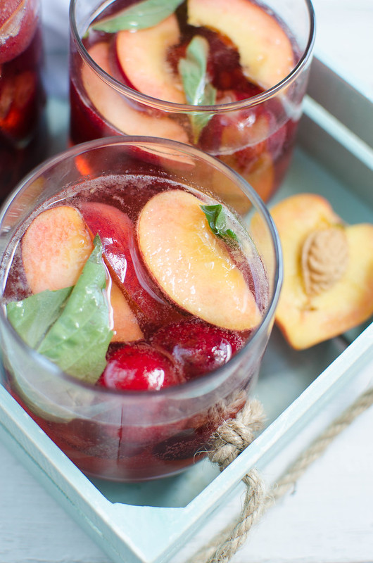 Peach Cherry Sangria - white wine sangria with peaches, cherries, and fresh basil! The perfect summer drink!
