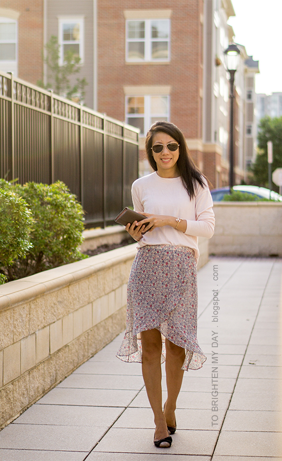 light pink sweater, wildflower cuff, taupe clutch, floral ruffle-wrap midi skirt, bow ballerina flats