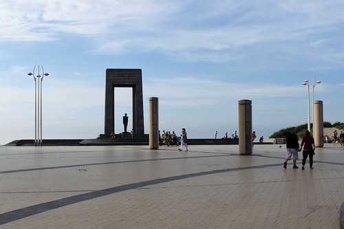 square with statue in front of coast
