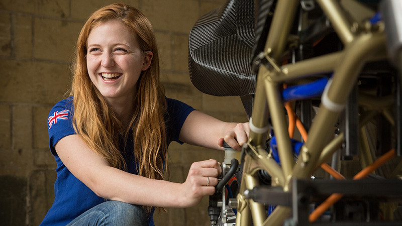 Student works on electric superbike outside