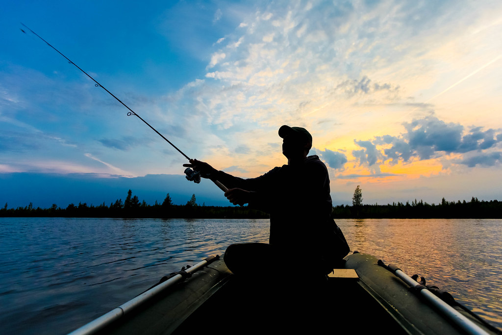 Fisherman silhouette with fishing rod is sitting in the in… | Flickr