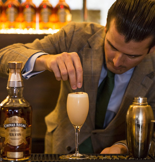 Erik Lorincz, Head Bartender American Bar at The Savoy, adds the all important finish touch