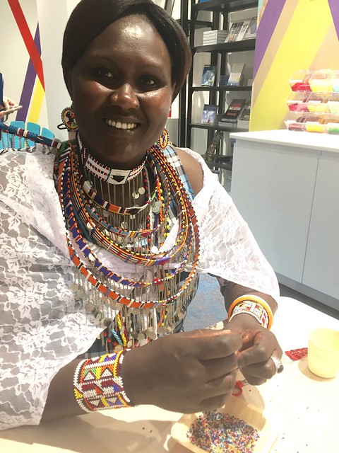 Mama Helen demonstrating bead work at the new WE store at the Rideau Centre