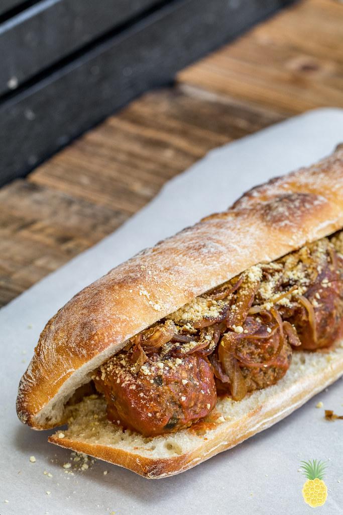 Vegan Meatball Sub Sandwich w/ Cashew Parmesan & Caramelized Onions (oil-free) sweetsimplevegan.com #oilfree #meatball #vegan #sub #hearty #caramelizedonions #homemadeparmesan #cashewparm #veganmeat