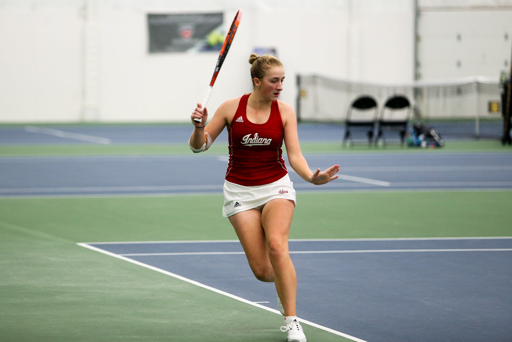 Kim Schmider prepares to return a shot during her singles match against Iowa's Aimee Tarun.