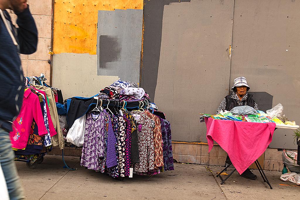 Woman selling on sidewalk--Toronto