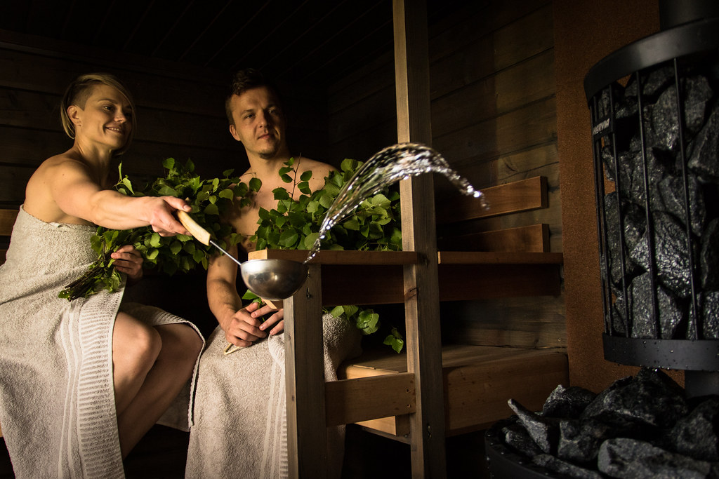 a couple in sauna woman throw water to kiuas in finnish flickr. Black Bedroom Furniture Sets. Home Design Ideas