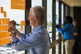 Laboratory Executive Director Dave Lyons adds his support to the Post With Pride art installation in the Otowi building breezeway windows that are visible from the Lab's main entrance.