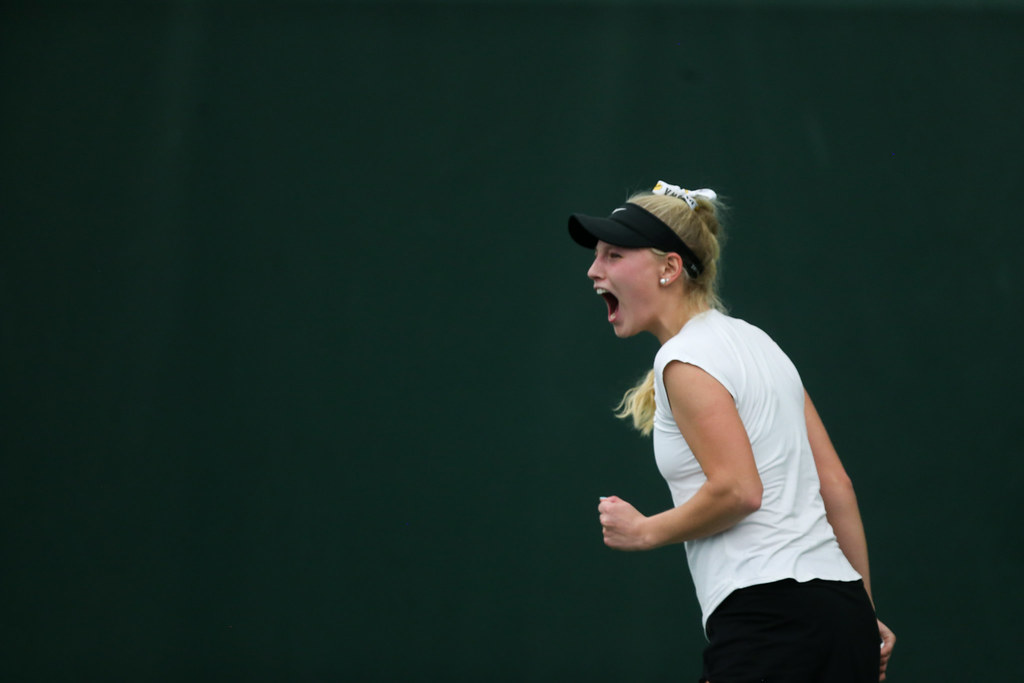 Iowa's Kristen Thoms celebrates after winning a set during her singles match.