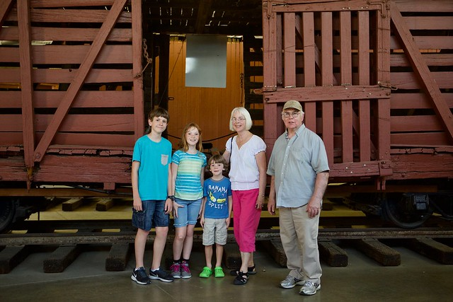 Grandparents and kids at train park